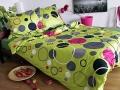 postelne-pradlo-bavlneny-saten-zeleny-farebne-kruhy